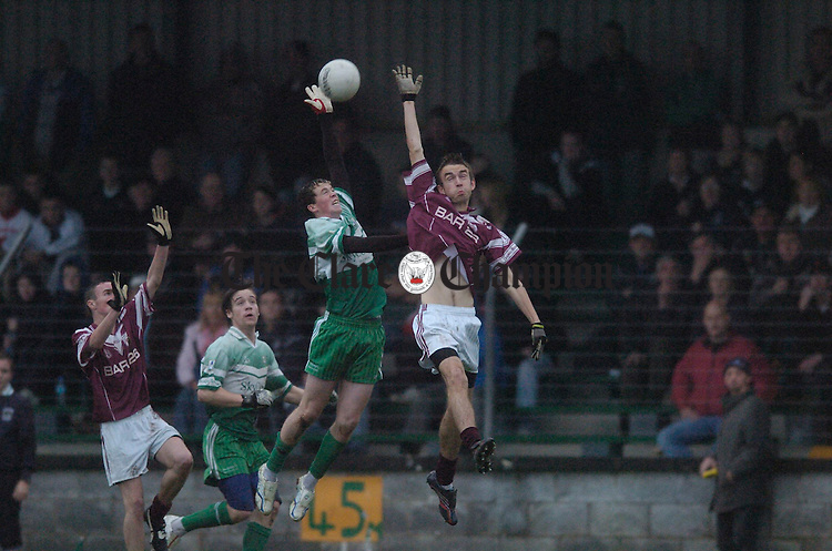 Gary Leahy of Wolfe Tones and Doora Barefield's Ricky Collins soar high during their Minor division one football final at Kilmihil Photograph by John Kelly.