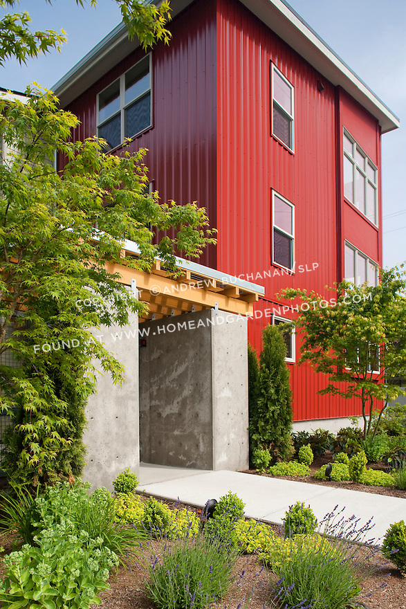 Barton Street Lofts; June, 2010; A concrete and wood archway provides entry to a bright red townhouse.
