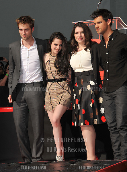 Robert Pattinson (left), Kristen Stewart, Twilight author Stephenie Meyers & Taylor Lautner at hand & footprint ceremony honoring the Twilight Saga stars at Grauman's Chinese Theatre, Hollywood..November 3, 2011  Los Angeles, CA.Picture: Paul Smith / Featureflash