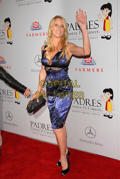 NICOLLETTE SHERIDAN.The 7th Annual El Sueno de Esperanza Benefit Gala to raise funds for Padres Contra El Cancer held at The Lot in West Hollywood, California, USA..October 18th, 2007.full length nicolette black clutch purse blue purple dress lace hand palm waving .CAP/DVS.©Debbie VanStory/Capital Pictures