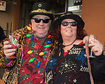 Bob McNamara and Tracy Candela during the Ugly Sweater Wine Walk in downtown  Reno on Saturday, Dec. 16, 2017.