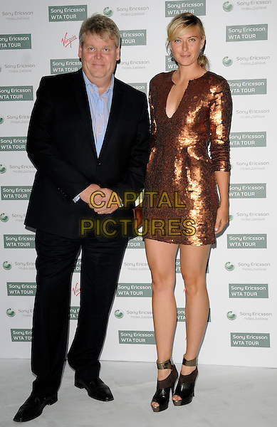 GUEST & MARIA SHARAPOVA.The WTA Pre-Wimbledon Party, The Roof Gardens, Kensington, London, USA..June 17th, 2010.full length bronze sequined sequin dress sleeves black peep toe ankle strap shoes suit.CAP/CAN.©Can Nguyen/Capital Pictures.