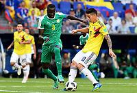 SAMARA - RUSIA, 28-06-2018: Cheikhou KOUYATE (Izq) jugador de Senegal disputa el balón con James RODRIGUEZ (Der) jugador de Colombia durante partido de la primera fase, Grupo H, por la Copa Mundial de la FIFA Rusia 2018 jugado en el estadio Samara Arena en Samara, Rusia. / Cheikhou KOUYATE (L) player of Senegal fights the ball with James RODRIGUEZ (R) player of Colombia during match of the first phase, Group H, for the FIFA World Cup Russia 2018 played at Samara Arena stadium in Samara, Russia. Photo: VizzorImage / Julian Medina / Cont