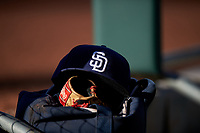 A San Diego Padres hat rests on a baseball glove before an Arizona League game between the AZL Padres 1 and AZL Cubs 1 on July 5, 2019 at Sloan Park in Mesa, Arizona. The AZL Cubs 1 defeated the AZL Padres 1 9-3. (Zachary Lucy/Four Seam Images)