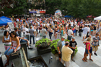 Charlotteans end the work day at the weekly (in summer) Alive After Five party in downtown Charlotte, NC every Thursday from April to August.