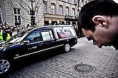 Warsaw 11/04/2010 Poland<br /> People mourning the tragic death of President Lech Kaczynski and his wife.<br /> on pictures: Cortege carrying the coffin with the President's remains drives through the streets of Warsaw.<br /> Photo: Adam Lach / Napo Images for The New York Times<br /> <br /> Zaloba po tragicznej smierci Prezydenta Lecha Kaczynskiego i jego malzonki.<br /> na zdjeciu: kordon z trumna Prezydenta Lecha Kaczynskiego na ul. Krakowskie Przedmiescie.<br /> Fot: Adam Lach / Napo Images for The New York Times