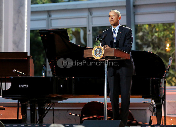 United States President Barack Obama delivers remarks at the International Jazz Day Concert on the South Lawn of the White House, in Washington, DC, April 29, 2016. The event includes a performance by Aretha Franklin and is presented by Morgan Freeman.<br /> Credit: Aude Guerrucci / Pool via CNP/MediaPunch