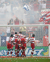 FC Dallas players, Roberto Mina (9), Chris Gbandi (4), Simo Valakari (17), and Mark Wilson (15) pile on Kenny Cooper after Cooper's goal at Pizza Hut Park on Sunday April 23, 2006. Dallas beat Kansas City 2-1.