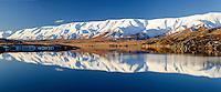 Snowy Hawkdun Ranges reflected in Falls Dam, near St Bathans, Central Otago, New Zealand - stock photo, canvas, fine art print