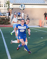 Boston Breakers midfielder Heather O'Reilly (9) advances to receive a pass with Chicago Red Stars defender Michelle Wenino (23) in pursuit.  In a National Women's Soccer League Elite (NWSL) match, the Boston Breakers defeated  Chicago Red Stars 4-1, at the Dilboy Stadium on May 4, 2013.