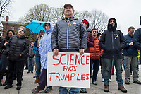"""Toby Sackton, 70, of Lexington, Mass., holds a sign reading """"Science Facts / Trump Lies"""" at the March for Science demonstration in Harvard University's Science Center Plaza in Cambridge, Massachusetts, on Sat., April 22, 2017. Sackton said he is a Harvard alum and a member of the American Association for the Advancement of Science, which calls itself """"the world's largest general scientific society."""""""