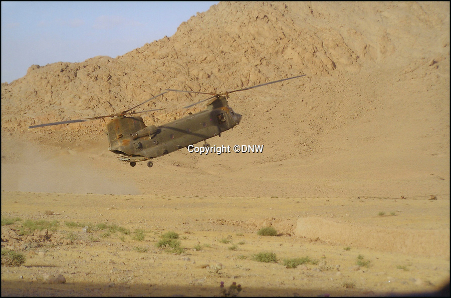 BNPS.co.uk (01202 558833)Pic: DNW/BNPS<br /> <br /> Squadron Leader Alex Duncan's Chinook under fire in Afghanistan, 2006.<br /> <br /> The amazing story of how a hero Chinook pilot miraculously kept a helicopter which was hit 34 times by Taliban rockets airborne saving the lives of 16 civilians on board can be told after his bravery medals emerged for sale for £50,000.<br /> <br /> Squadron Leader Alex Duncan was at the controls of a Chinook carrying a group of VIPs including the Governor of Helmand Province when it fell victim to an assassination plot on May 17, 2008.<br /> <br /> Rockets blew away most of a rotor blade and left a huge hole in the fuselage, causing the helicopter to spin violently out of control, but Sq Ldr Duncan somehow stopped the Chinook from crashing and located a safe spot to offload the relieved passengers.<br /> <br /> Just six days later, Sq Ldr Duncan was once again in the thick of it, leading a wave of Chinook helicopters delivering paratroopers against a tenacious enemy under intense enemy fire during a dangerous night mission. <br /> <br /> Those two acts of bravery led to him being awarded a Distinguished Flying Cross which has emerged for sale alongside his Air Force Cross granted after he flew in complete darkness in the middle of a battle to rescue an injured six year old child.