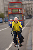 An elderly  cyclist using a cycle lane in central London.