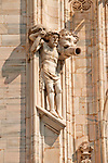 Duomo (Cathedral) facade detail of a statue that is also a rain spout