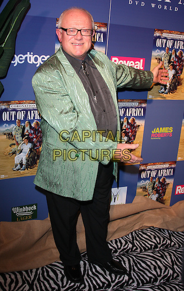 "KEN MORLEY.Coronation Street ""Out Of Africa"" DVD Premiere at Odeon Cinema, The Printworks, Manchester, England..November 4th, 2008.full length green jacket glasses .CAP/ROS.©Steve Ross/Capital Pictures."