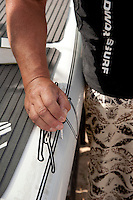 Repairing a scratch on a Boardworks Surf Rusty stand up paddleboard.