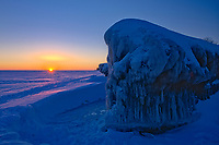 Ice on shore of Lake Winnipeg at sunrise, Winnipeg Beach, Manitoba, Canada