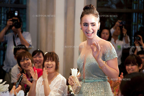 """July 18, 2012, Tokyo, Japan - The actress Lily Collins (Snow White) attends the Premier of """"Mirror Mirror"""" and waves to the audience at St. Grace Cathedral in Tokyo. The """"Mirror Mirror"""" film tells the story of an orphaned princess called Snow White (Lilly Collins) and her cruel stepmother the Queen (Julia Roberts) who plans to take over the kingdom. The Queen tries to get rid of Snow White by throwing the forest, but princess is rescued by a band of diminutive highway robbers, and with them she seeks to recover her kingdom. This film will be released from September 14 in Japan. (Photo by Rodrigo Reyes Marin/AFLO)"""