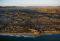 aerial photograph Monarch Beach, Orange County, California; the Ritz-Carlton Laguna Niguel, Salt Creek Beach and the Monarch Beach Golf Links are in the foreground.  Residential communities toward San Juan Capistrano including Niguel Shores and the Villas at Monarch Beach above the shoreline.