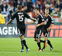 Chris Pontius (13) of D.C. United celebrates his goal with teammate Ethan White during the game at RFK Stadium in Washington, DC.  D.C. United tied the Colorado Rapids, 1-1.
