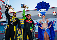 Oct 29, 2017; Las Vegas, NV, USA; NHRA funny car driver Matt Hagan (left) and top fuel driver Terry McMillen celebrate after winning the Toyota National at The Strip at Las Vegas Motor Speedway. Mandatory Credit: Mark J. Rebilas-USA TODAY Sports