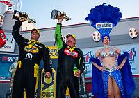 Oct 29, 2017; Las Vegas, NV, USA; NHRA funny car driver Matt Hagan (left) and top fuel driver Terry McMillen celebrate after winning the Toyota National at The Strip at Las Vegas Motor Speedway. Mandatory Credit: Mark J. Rebilas-USA TODAY Sports