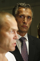 (Oslo July 22, 2011) Dr. P&aring;l Aksel N&aelig;ss breifs journalists with Prime minister Jens Stoltenberg in the backround, at Ullev&aring;l Hospital.<br /> A  large vehicle bomb was detonated near the offices of Norwegian Prime Minister Jens Stoltenberg on 22 July 2011. Although Stoltenberg was reportedly unharmed the blast resulted in several injuries and deaths. <br /> Another terrorist attack took place shortly afterwards, where a man killed over 80 children and youths attending a political camp at Ut&oslash;ya island. <br /> Anders Behring Breivik was arrested on the island and has admitted to carrying out both attacks.<br /> (photo:Fredrik Naumann/Felix Features)