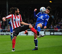 Lincoln City's Michael Bostwick vies for possession with Chesterfield's Joe Rowley<br /> <br /> Photographer Chris Vaughan/CameraSport<br /> <br /> The EFL Sky Bet League Two - Lincoln City v Chesterfield - Saturday 7th October 2017 - Sincil Bank - Lincoln<br /> <br /> World Copyright &copy; 2017 CameraSport. All rights reserved. 43 Linden Ave. Countesthorpe. Leicester. England. LE8 5PG - Tel: +44 (0) 116 277 4147 - admin@camerasport.com - www.camerasport.com