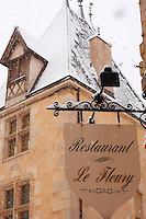Restaurant Sign in the snow. Beaune. France