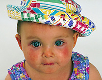 Baby in colorful hat. Baby. Douglaston NY.