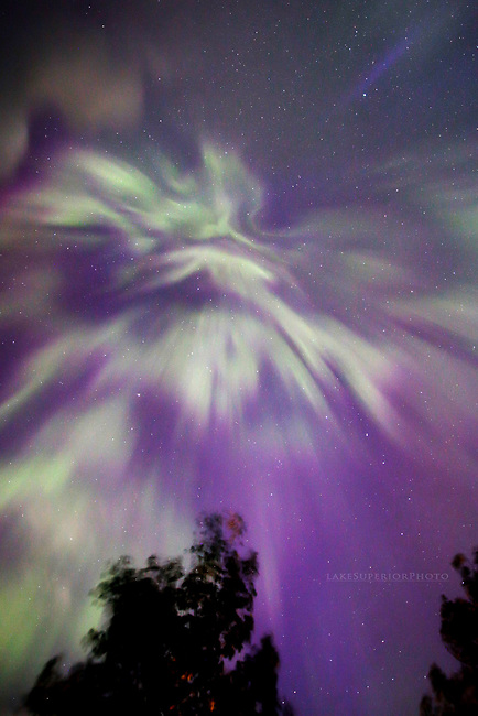 purple and green aurora corona