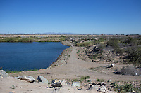 MEXICALI, MEXICO - March 14. A general view of the US-Mexico Border where the river ends at the Morelos Dam on March, 14  2019 in Mexicali, Mexico.<br /> The rivers usually end in the sea, the Colorado dies in a border. Its the only case like this in the world. There is less water in the Colorado River, hence less water in crops and areas of northern Mexico.  <br /> (Photo by Luis Boza/VIEWpress)