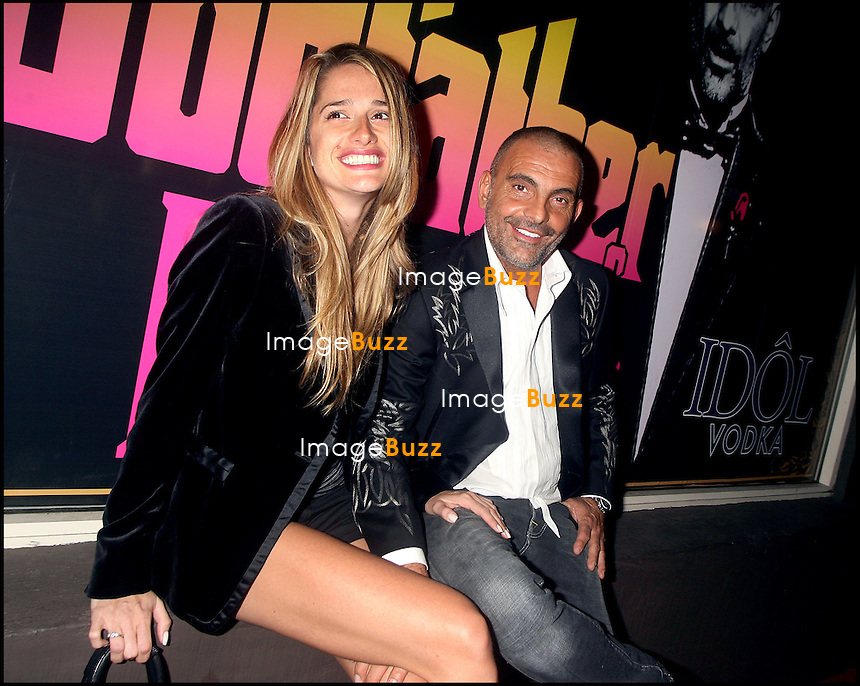 CHRISTIAN AUDIGIER ET SA FEMME - LE STYLISTE FRANCAIS CHRISTIAN AUDIGIER &quot;ED HARDY&quot; CELEBRE SA NOUVELLE EMISSION DE TELE REALITE &quot;THE GODFATHER OF FASHION&quot; A LOS ANGELES<br /> FRENCH DESIGNER CHRISTIAN AUDIGIER &quot; ED HARDY &quot; CELEBRATES HIS NEW REALITY SHOW  &quot; THE GODFATHER OF FASHION &quot;.<br /> LOS ANGELES, OCTOBER 19, 2006.<br /> <br /> Pic : Christian Audigier &amp; wife