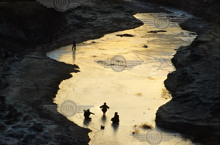 Children play on the ice of the frozen Yellow River..