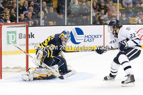 Joe Cannata (Merrimack - 35), Stevie Moses (UNH - 22) - The Merrimack College Warriors defeated the University of New Hampshire Wildcats 4-1 (EN) in their Hockey East Semi-Final on Friday, March 18, 2011, at TD Garden in Boston, Massachusetts.