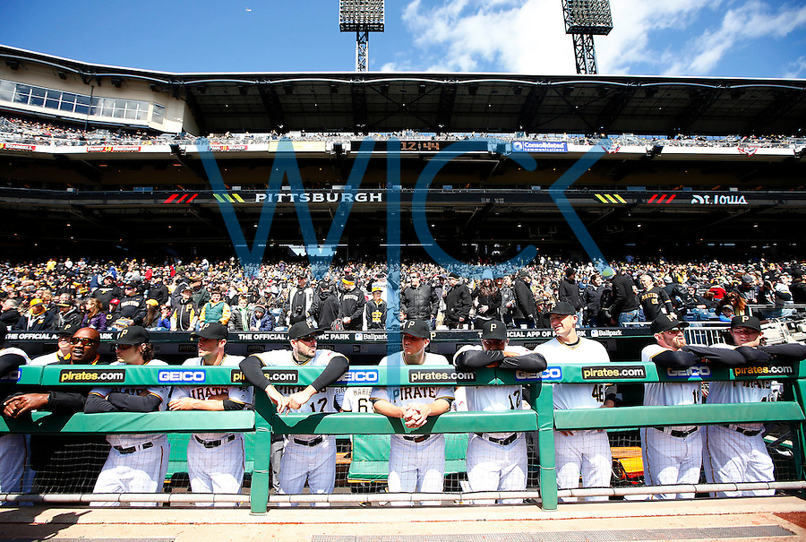 Members of the Pittsburgh Pirates stand in the dugout prior to the start of the Opening Day game against the St. Louis Cardinals at PNC Park in Pittsburgh, Pennsylvania on April 3, 2016. (Photo by Jared Wickerham / DKPS)