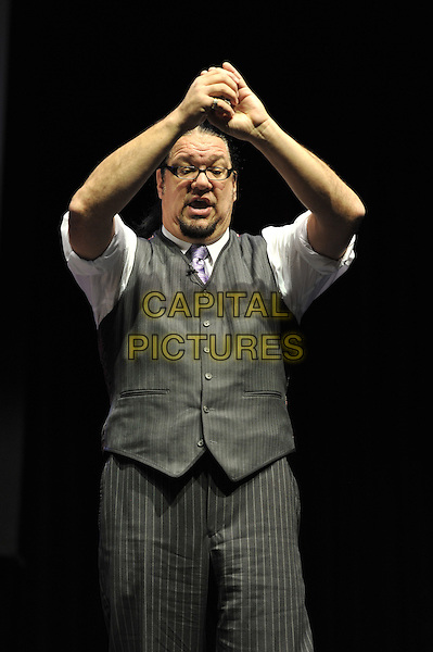 Penn Jillette .Penn and Teller performing 'Conversations with Penn and Teller - 35 Years of Magic and Bulls'%+t', indigo2, Greenwich, London, England. .7th December 2011.bullshit stage concert performing performance half length grey gray waistcoat white shirt pinstripe arms in air glasses mouth open.CAP/MAR.© Martin Harris/Capital Pictures.