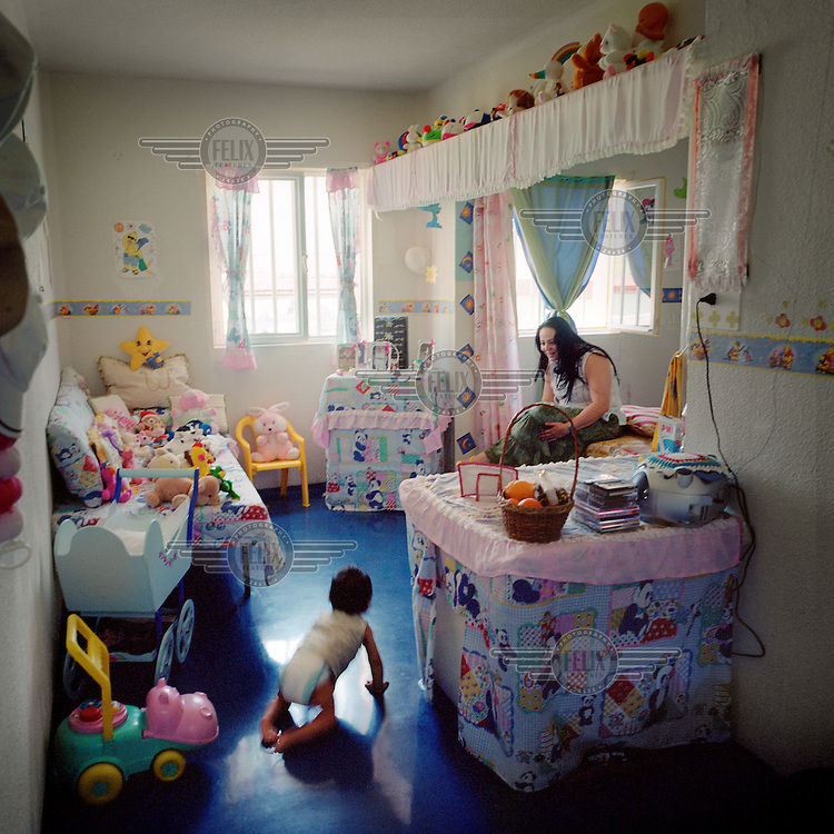 A mother and baby in Aranjuez prison, which contains a number of family cells where couples can live together with their children, until the children reach the age of three.