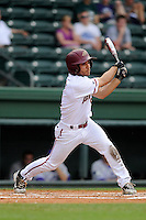 Center fielder Sebastian Gomez (5) of the Elon Phoenix bats in a game against the Furman Paladins in a first-round Southern Conference playoffs game on Wednesday, May 22, 2013, at Fluor Field at the West End in Greenville, South Carolina. Furman won, 10-1. (Tom Priddy/Four Seam Images)