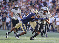 Annapolis, MD - October 21, 2017: Navy Midshipmen linebacker Justin Norton (5) tackles UCF Knights wide receiver Gabriel Davis (13) during the game between UCF and Navy at  Navy-Marine Corps Memorial Stadium in Annapolis, MD.   (Photo by Elliott Brown/Media Images International)
