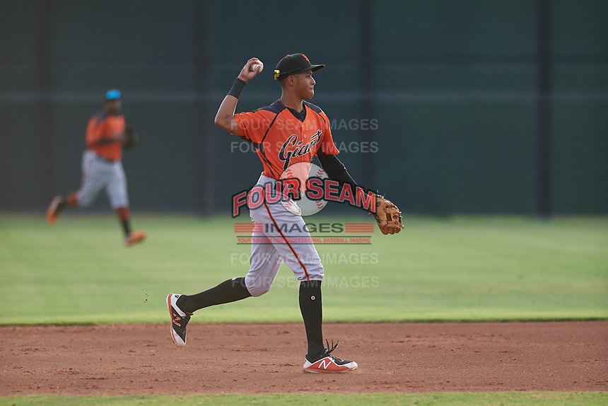AZL Giants Orange second baseman Edison Mora (18) throws to first base during an Arizona League game against the AZL Giants Black on July 19, 2019 at the Giants Baseball Complex in Scottsdale, Arizona. The AZL Giants Black defeated the AZL Giants Orange 8-5. (Zachary Lucy/Four Seam Images)