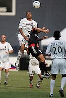 The MetroStars' Ricardo Clark goes up for a header over D.C. United's Ben Olsen. D.C. United defeated the NY/NJ MetroStars 6 to 2 at RFK Stadium, Washington, D.C., on July 3, 2004.