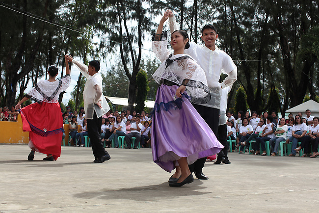 "Young people wearing traditional Filipino costumes perform the ""kariñosa,"" a folk dance, during annual Independence Day celebrations in the town of Sindangan, on Mindanao island, Philippines. June 12, 2011."