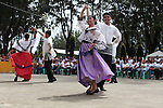"""Young people wearing traditional Filipino costumes perform the """"kariñosa,"""" a folk dance, during annual Independence Day celebrations in the town of Sindangan, on Mindanao island, Philippines. June 12, 2011."""