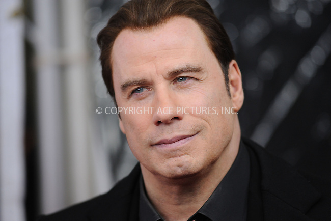 WWW.ACEPIXS.COM . . . . . ....January 28 2010, New York City....Actor John Travolta arriving at the 'From Paris With Love' premiere at the Ziegfeld Theatre on January 28, 2010 in New York City. ....Please byline: KRISTIN CALLAHAN - ACEPIXS.COM.. . . . . . ..Ace Pictures, Inc:  ..(212) 243-8787 or (646) 679 0430..e-mail: picturedesk@acepixs.com..web: http://www.acepixs.com