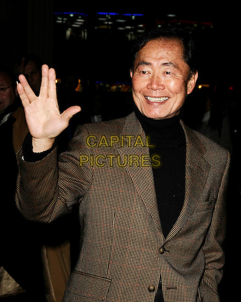 "GEORGE TAKEI aka Mr. Sulu .At the After Party for ""Clubbed"" Gala Screening at Ruby Blue in Leicester Square, London, England,.January 7th 2009..half length star trek hand sign brown plaid check suit jacket blazer black polo neck .CAP/CAN.©Can Nguyen/Capital Pictures"