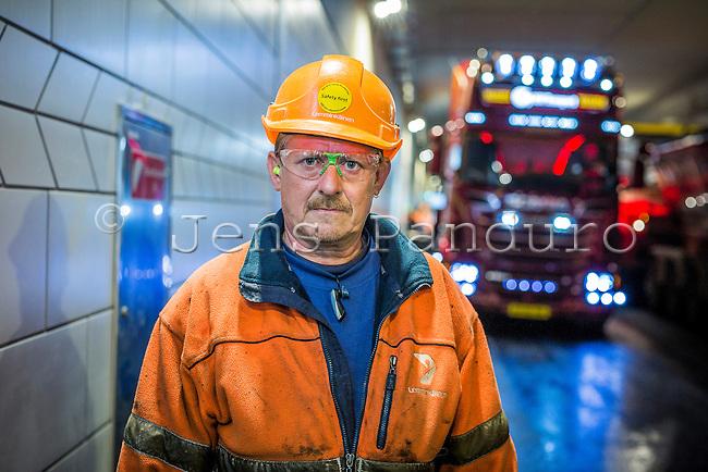 Thony Hansen. Asphaltworkers from Lemmink&auml;inen in Nordhavnstunnellen in &Oslash;sterbro in Copenhagen, Denmark.<br /> <br /> <br /> Foto: Jens Panduro