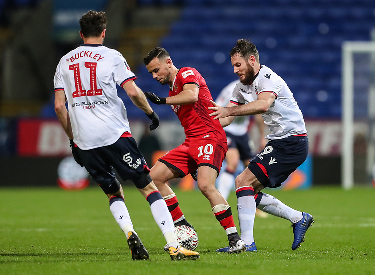Bolton Wanderers' Jonathan Grounds and Will Buckley combine to tackle Walsall's Zeli Ismail<br /> <br /> Photographer Andrew Kearns/CameraSport<br /> <br /> Emirates FA Cup Third Round - Bolton Wanderers v Walsall - Saturday 5th January 2019 - University of Bolton Stadium - Bolton<br />  <br /> World Copyright © 2019 CameraSport. All rights reserved. 43 Linden Ave. Countesthorpe. Leicester. England. LE8 5PG - Tel: +44 (0) 116 277 4147 - admin@camerasport.com - www.camerasport.com