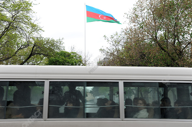 Passengers in a bus drove past an Azeri flag flying on the world's tallest flag pole in the capital, Baku, Azerbaijan, May 15, 2011