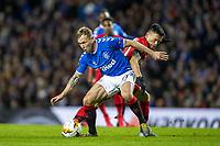 12th March 2020, Ibrox Stadiu, Glasgow, Scotland; Europa League football, Glasgow Rangers versus Bayer Leverkusen;  Glasgow's Scott Arfield holds off Leverkusen's Charles Aranguiz